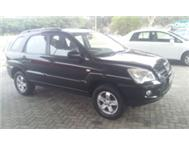 VERY CLEAN IN AND OUT KIA SPORTAGE 2.0 AUTO BLACK LOW KMS