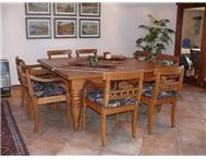 Solid OAK Dining Table with 8 x oak arm chairs.