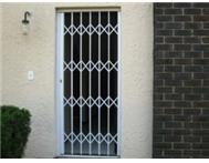 SLAMLOCK SECURITY BARRIERS - TRELLIS DOORS