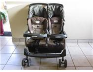 Metallicneutral & black Peg Perego double pram with baby bag
