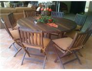 SOLID TEAK ROUND DINING / PATIO TABLE WITH 8 CHAIRS AND CUSHIONS