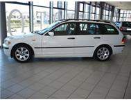 2005 BMW 318i Touring A/T (E46). White.