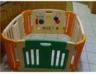 Play pen with activity centre and door - R600