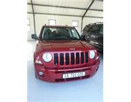 2009 Jeep 2L Patriot by Pre-Owned Stars Great Fuel Economy!
