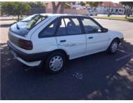 1995 Ford Laser FOR SALE white it s a 1.6i.