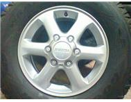 Isuzu mag rims 16 inch with tyre size 245-70-16 set